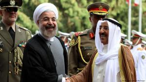 Iranian President Hassan Rouhani (l) greets Amir of Kuwait, Sheikh Sabah al-Ahmad al-Sabah (r) upon his arrival in Tehran on 1 June 2014. Kuwait's Emir started a landmark visit to Tehran focussed on mending fences between Shia Iran and the Sunni-ruled monarchies in the Gulf (photo: Atta Kenare/AFP/Getty Images)