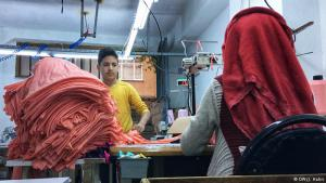 Work piling up: Khalil is 13 years old and comes from Damascus. He works five days a week in this tailorʹs workshop in the basement of a residential house in the working-class Istanbul district of Bagcilar. In this area there are sewing rooms like this one in almost every street. And there are almost always children like Khalil working in them