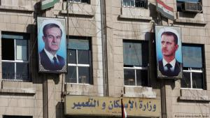 Placards of Hafez al-Assad and Bashar al- Assad (photo: picture-alliance/dpa/R. Jensen)