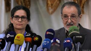 Ilham Ahmed and Riad Darar, co-chairs of the Syrian Democratic Council (SDC), are seen during its third meeting in Tabqa, Syria, 16 July 2018. (photo: Reuters/Rodi Said)