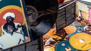 """""""Two Niles to Sing a Melody: The Violins & Synths of Sudan"""" CD cover and booklet (released by Ostinato Records)"""