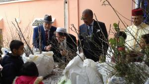 U.S. Ambassador to the Kingdom of Morocco, Dwight Bush, Sr., the provincial governor, Younes Elbathaoui, the president of the Moroccan Jewish Community of Marrakech-Safi, Jacky Kadoch, and president of the High Atlas Foundation, Yossef Ben-Meir distribute fruit trees to farmers and schoolchildren in 2016 (photo: High Atlas Foundation)