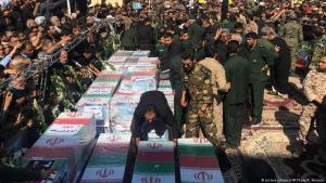 Caskets of those who died in a terror attack on a military parade in Iran are displayed in Ahvaz, Iran, 24 September 2018 (photo: picture-alliance/AP Photo/E. Noroozi)