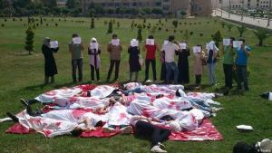 Students lie on the ground to depict a massacre as they take part in an anti-government protest at Aleppo University, 4 June 2012 (photo: Reuters)
