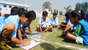 "Kids in Rurka Kalan, India decide on fair play rules as part of the ""Kick for Tolerance"" initiative (photo: YFC Rurka Kalan)"