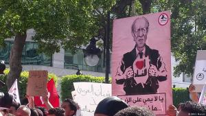 "Protests against President Beji Caid Essebsi and Tunisiaʹs government: ""I love corruption"" reads the placard (photo: S. Mersch/DW)"