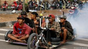 "Vesperados astride their ""wasps"": once a year, when the countryʹs Vespa fans hold their meet, the town of Kediri in the east of the Indonesian island of Java is shrouded in two-stroke exhaust. Those attending proudly present their own Italian cult scooters, some of which have been pimped beyond recognition"