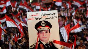 Supporters of Egypt's army chief General Abdul Fattah al-Sisi hold a poster of Sisi in Tahrir square in Cairo, on the third anniversary of Egypt's uprising, 25 January 2014 (photo: Reuters/Mohamed Abd El-Ghany)