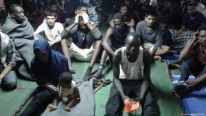 Migrants refuse to leave a container ship, having been rescued at sea and returned to Misrata, Libya (photo: picture-alliance/dpa)