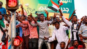 Sudanese protesters in Khartoum on 12 April 2019 following the overthrow of long-time dictator of Omar al-Bashir (photo: Getty Images/AFP/Ashraf Shazly)
