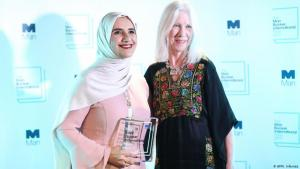 Arabic author Jokha Alharthi (l) and translator Marilyn Booth pose after winning the Man Booker International Prize for the book 'Celestial Bodies' in London on 21 May 2019 (photo: AFP/I. Infantes)