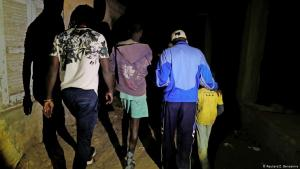 Mamadou Gueye (second right), a street child educator, and Issa Kouyate (left), founder of Maison de la Gare, an organisation that helps talibe street children reintegrate into society, escort an eight-year-old talibe boy and a teenager (green shorts) during a night patrol in Saint-Louis, Senegal, on 9 February 2019. Gueye and Kouyate rescued the boy when the teenager was raping him at a bus station (photo: Zohra Bensemra)