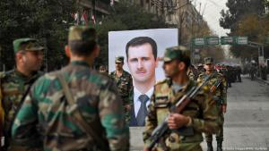 Forces loyal to the Syrian regime celebrate the anniversary of the re-taking of Aleppo from the Syrian rebels on 21.12.2017 (photo: Getty Images/AFP)
