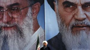Iranian President Hassan Rouhani makes an address in front of portraits of the supreme leader Ayatollah Ali Khamenei, left, and Ayatollah Khomeini, the founder of the Islamic Republic during a ceremony marking his 25th death anniversary at his shrine just outside Tehran, Iran, on 3 June 2014 (photo: picture-alliance/AP Photo/V. Salemi)
