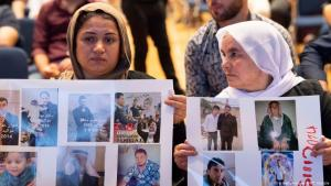 Yazidi women hold up pictures of missed relatives during a commemoration ceremony in Stuttgart, southern Germany, on 3 August 2019 (photo: Getty Images/AFP/T. Kienzle)