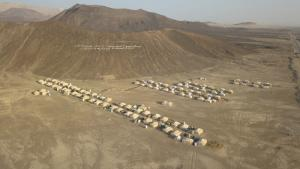 "The mountainside on the outskirts of Marib reads ""IDPs camp – Sanaa Consortium for Relief"" (photo: Ahmed Nagi)"