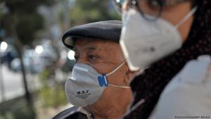 Iranians wearing face masks to protect against coronavirus (photo: picture-alliance/AA/F. Bahrami)