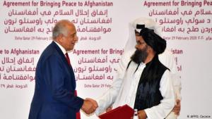 U.S Special Representative for Afghanistan Reconciliation Zalmay Khalizad and Taliban co-founder Mullah Abdul Ghani Baradar shake hands after signing a peace agreement during a ceremony in the Qatari capital Doha on 29 February 2020 (photo: AFP/G. Cacace)