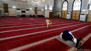 A man prays in an empty mosque in Baghdad (photo: Reuters/K. Al-Mousily)