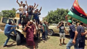 Supporters of the Libyan transitional government celebrate their territorial gains (photo: AFP/Getty Images)