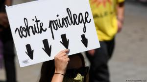 Anti-racism demonstrator in Barcelona holds up a placard - Down with white privilege! - on 14 June 2020 (photo: Getty Images/AFP/J. Lago)