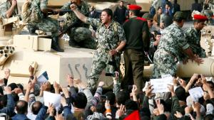 Celebrating the military during the uprising against Mubarak in 2011, Cairo (photo: Reuters)