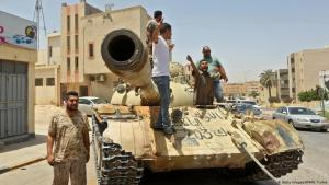 Fighters loyal to Libya's UN-backed Government of National Accord stand on a tank (photo: Getty Images/AFP/M. Turkia)