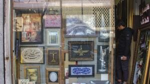 A Christian cross, a Zoroastrian symbol of Faravahar and calligraphy by Ayatul Kursi from the Koran on display together in a picture-framing shop (photo: Changiz M. Varzi)