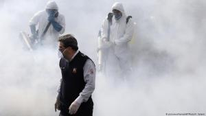 Disinfection measures against the coronavirus in Iran (photo: picture-alliance/AP/V. Salemi)