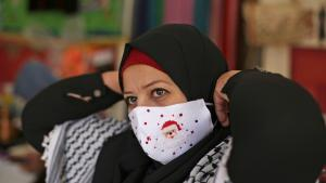 The masks, decorated with images of Santa Claus, reindeer and Christmas trees, have found markets as far away as Europe. They also have provided a small lift to a Palestinian enclave run by the Islamic militant Hamas group and where the vast majority of residents are Muslim