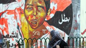 A street mural showing a wounded boy (photo: picture-alliance/dpa/Khaled Elfiqi)