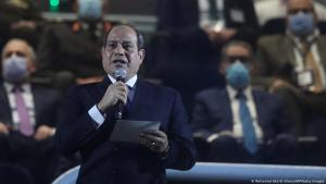 Egyptian president Abdel Fattah al-Sisi (front) delivers a speech in grandstand before the opening match of the 2021 World Men's Handball Championship between Group G teams Egypt and Chile at the Cairo Stadium Sports Hall in the Egyptian capital on 13 January 2021 (photo: Getty Images/AFP/Pool/Mohamed Abd El Ghany)
