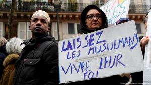 "The poster of a demonstrator against Islamophobia in Paris reads: ""Let Muslims have their faith"" (photo: Getty Images/ AFP)"