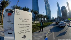 Vaccination signage in Dubai (photo: Karim Sahib/AFP/Getty Images)