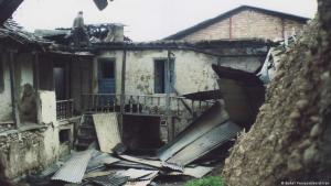 A man surveys damage to a Baha'i house in the village of Ivel (photo: Baha'i Persecution in Iran)