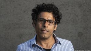 Iraqi author Usama Al Shahmani (photo: Ennio Leanza/Keystone/picture-alliance)