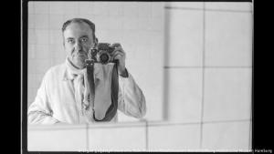 """Ergun Cagatay phographs himself in a mirror using a 35-mm camera. Photo from the exhibition """"We are from here; German-Turkish life in 1990"""""""