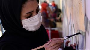 A female artist at work in Afghanistan (photo: Shah Maral/AFP/Getty Images)
