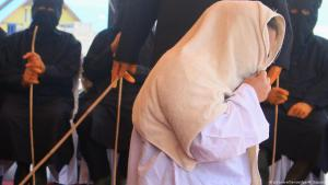 Public flogging of a woman, Aceh, Indonesia (photo: picture-alliance/dpa)