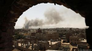 Smoke cloud over Sanaa after an airstrike (photo: Khaled Abdullah/Reuters)