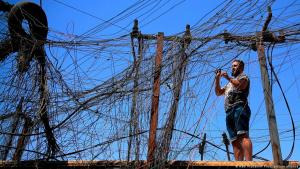 Muqtada Haider turns the switches to transfer electricity to private homes in Baghdad, Iraq, Friday, 10 September 2021 (AP Photo/Hadi Mizban)