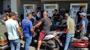 Men wait at a petrol station in Lebanon.