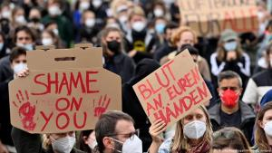 """Protest in Berlin regarding the evacuation of civilians from Afghanistan; the German placard reads """"Blood on your hands"""" (photo: AFP/Getty Images)"""
