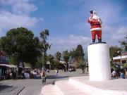 Man inSanta Claus sculpture at square in front of the Saint Nicolas church in Demre, Turkey (photo: Wikipedia)