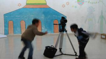 Palestinian boys on a film set (photo: Palestinian social cinema arts association)
