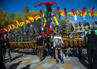 Heading up the Ashura parades is the alam – Hussein's coat of arms. The alam is decorated with feathers, flags and verses of the Koran engraved on the flexible metal blades, which sway like the branches of a tree. The metallic artwork represents the hand of Abbas, flag bearer during the battle of Karbala