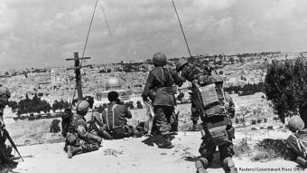 Mount of Olives then: if it weren't for the ancient Ottoman city wall and the shrine in the background, viewers might not realise this is the same site. The picture was taken on 7 June 1967, when the peak was this brigade's command post at the height of the Six-Day War, or Arab-Israeli War