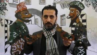 Syria's last shadow puppeteer Shadi al-Hallaq with Karakoz and Eiwaz (photo: AFP)