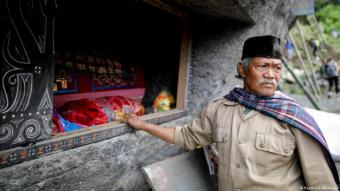 """The ancient Torajan burial ritual is also known as """"Ma'nene"""", in which clans visit the tombs of deceased family members, clean their remains and replenish the coffins with personal belongings"""