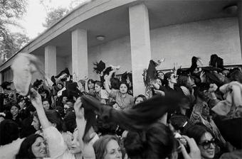 A group of women protesting against wearing the Islamic veil, while waving their veils in the air outside the office of the prime minister in Tehran, Iran, in March 1979 (photo: Kaveh Kazemi/Getty Images)